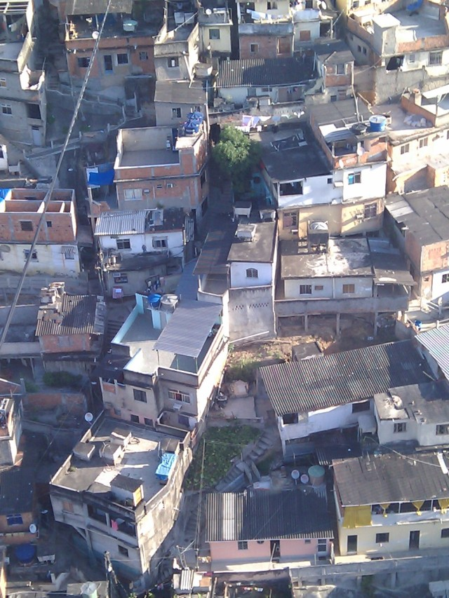 Whose houses get town down to make space and bring light and air to favelas?